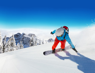 Snowboarder running downhill