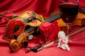 Violin, red rose and wine.