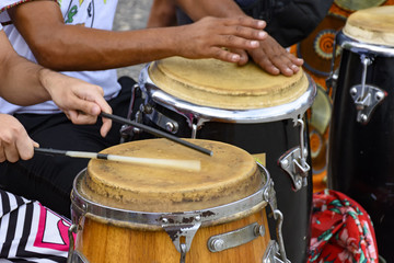 Percussion instrument called atabaque being played in traditional Brazilian party