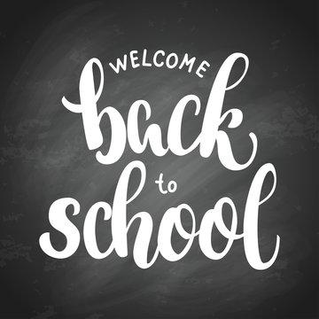 Welcome back to school hand brush lettering, on black chalkboard background. Vector illustration.