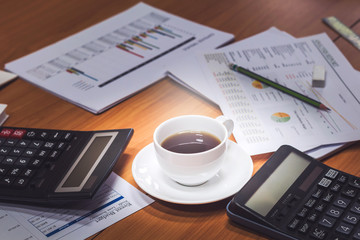 Close-up of business man holding cups of coffee