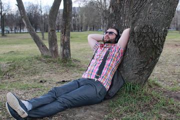 beard man relax tree