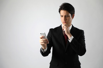 young businessman looking at a smart phone