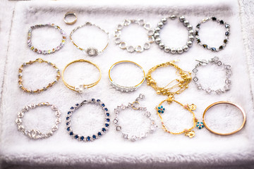 Costume Jewelry accessories such as Ring, Earrings, diamond, pebble, bracelet, gold, silver, necklace, jade, pearl, Vanity top for women .