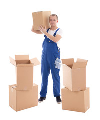 moving day concept - young man in blue workwear with cardboard b