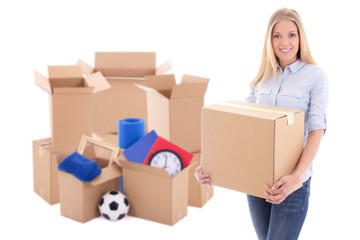 moving day concept - beautiful woman with brown cardboard boxes