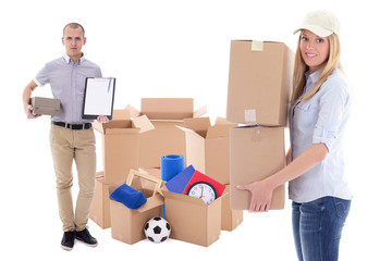 moving day or delivery concept - man and woman with brown cardbo
