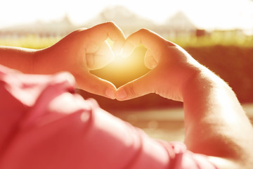 Female hands in the form of heart. Hands in shape of love heart