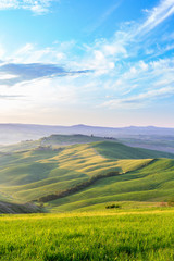 Morning light in a rolling Tuscan landscape in Italy