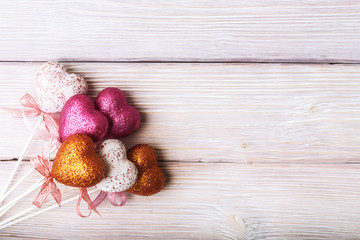 Valentines day hearts over old wooden background with copy space