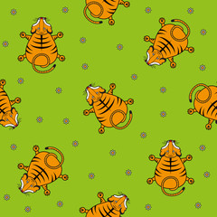 Seamless vector pattern for children. Tiger cub top view and chamomile on a green background.