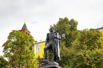 Bottom view of statue of Russian emperor Alexander I at Alexandrovsky Garden in Moscow. Park with lawns, summer blooms & several monuments including one to Marshal Georgy Zhukov.
