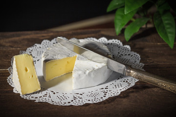Camembert cheese on a rustic background.Exquisite cheese.