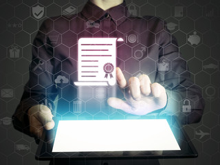Concept of online learning. Person  touches to certificate icon  (diploma). She  holds tablet pc, that contains a many different online services.