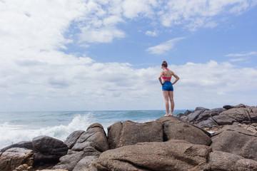 Girl Watching Ocean Waves Rocks