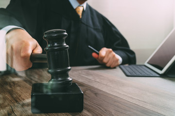 justice and law concept.Male judge in a courtroom striking the g