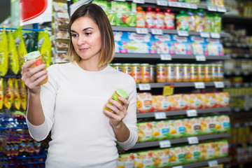 Young female shopper searching for baby food