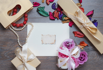 Valentines day photo frame or greeting card and handmade hearts over wooden table.