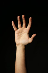 Male hand on a black background