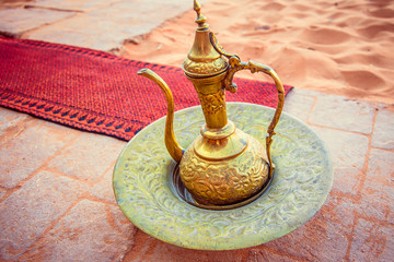 amazing golden arabic coffee pot is served in bedouin tent