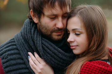 Stylish man and woman in a scarf on nature