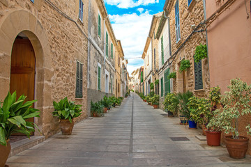 Beautiful narrow old street in mediterranean city.
