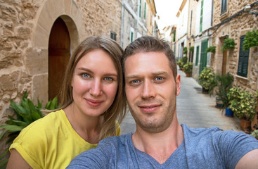 Lovely couple taking selfie in old town.