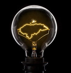 Lightbulb with a glowing wire in the shape of Honduras (series)