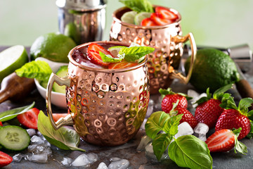 Moscow mule cocktail with lime and strawberry