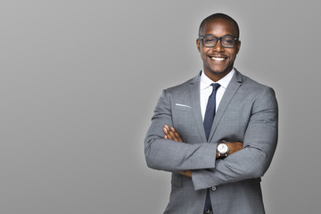 Cheerful african american businessman with a charming smile accomplished proud and successful