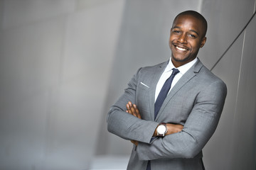 Happy smiling portrait of a successful confident african american corporate executive business man