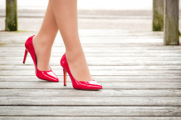female legs in red Louboutin