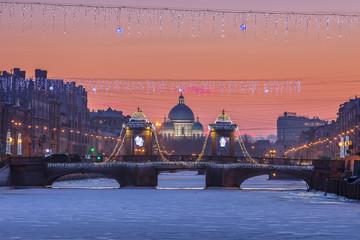 Saint Petersburg Lomonosov Bridge and Trinity Cathedral at sunse