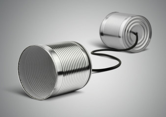 Tin cans telephone with cord on grey, telephony concept