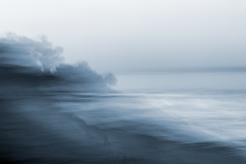 Motion Blurred Seascape. A monotone, blurred seascape made using a long exposure combined with horizontal panning motion. Wall mural