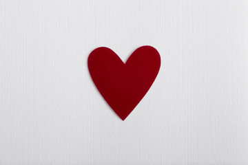 Red love heart  on a textured paper background