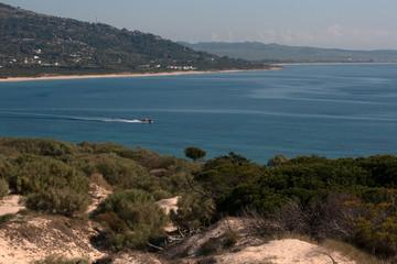 Punta Paloma beach .  Playa Punta Paloma. Mountains.