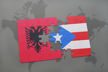 puzzle with the national flag of albania and puerto rico on a world map