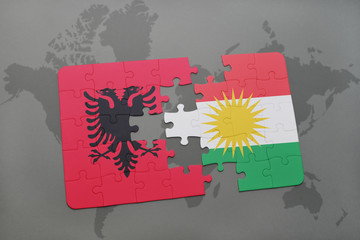 puzzle with the national flag of albania and kurdistan on a world map