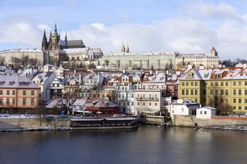 Snowy freeze Prague Lesser Town with gothic Castle above River Vltava, Czech republic