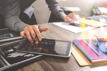 Website designer holding smart phone and working computer digita