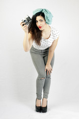 pinup style girl with red lips on a white background is holding