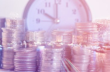 Double exposure rows of coins and alarm clock with city background, Finance and money saving concept