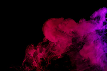 Abstract smoke Weipa. Personal vaporizers fragrant steam. The concept of alternative non-nicotine smoking. Lilac smoke on a black background. E-cigarette. Evaporator. Taking Close-up. Vaping.