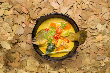 white snapper fish curry soup with tomato, red chilli, and lime