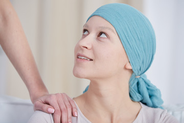 Woman after chemotherapy wearing headscarf