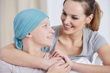 Hopeful cancer woman with friend