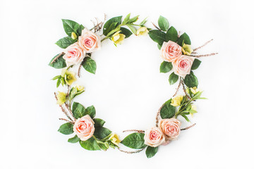 Frame of pink roses, branches, leaves and petals isolated on white background. Flat lay, top view