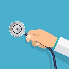 Hand holding stethoscope.