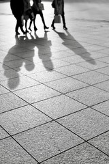 Shadows of People on Paving